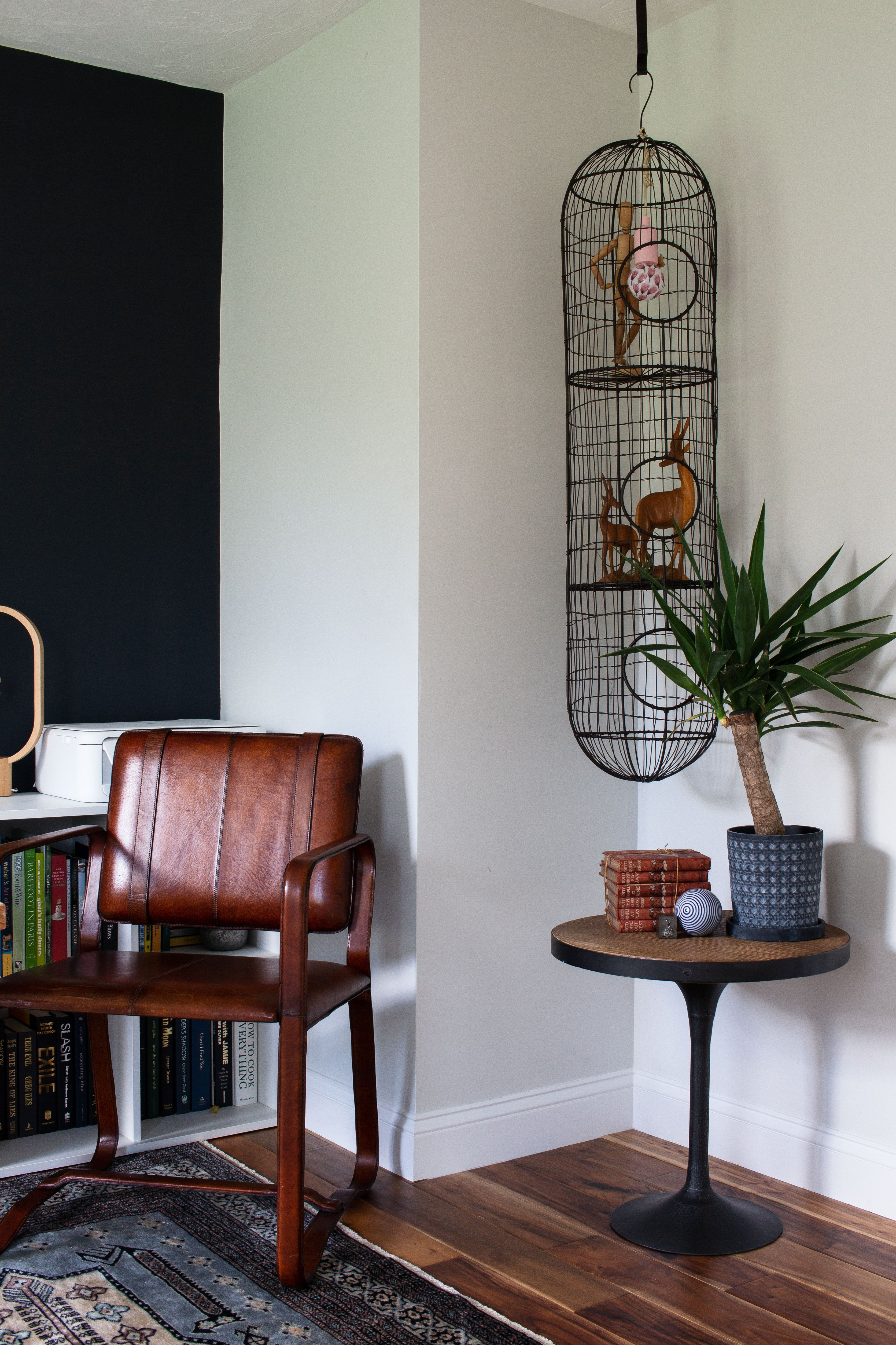 Graphic Home Office: One Room Challenge. A super cool thrifted cage fills the awkward vertical space by the desk.