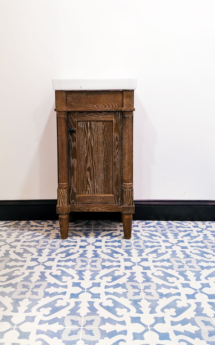 Gorgeous feiminie, cement look tile, classic tiny vanity.