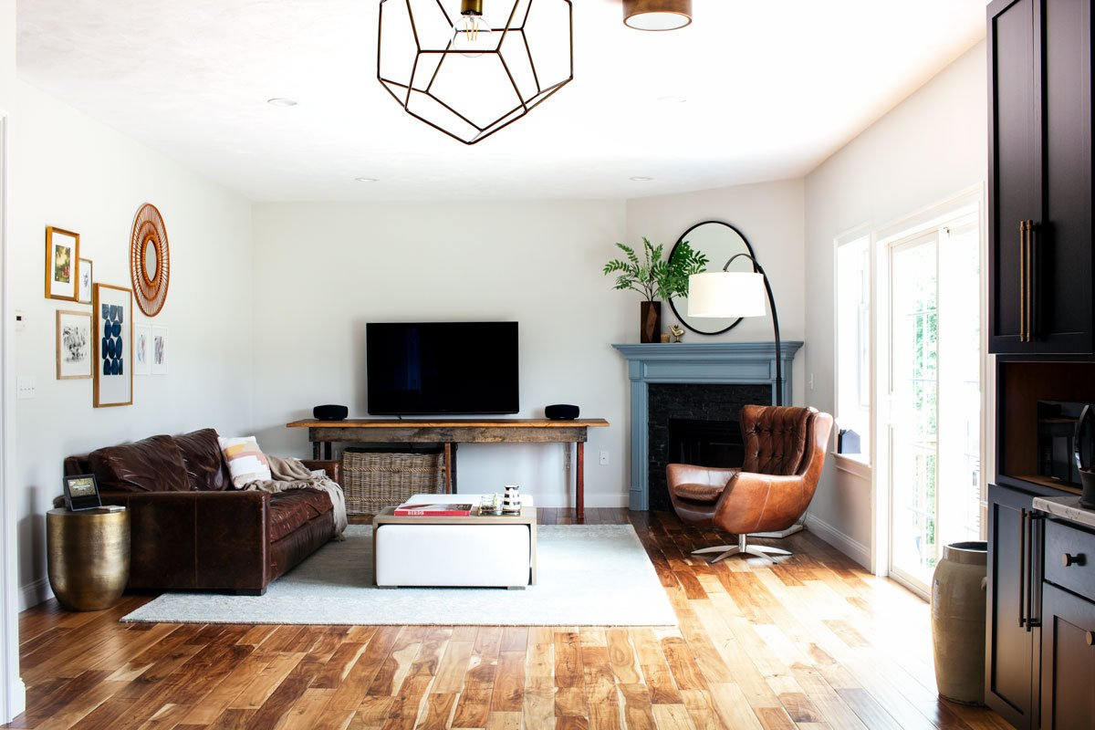 Shop my eclectic transitional living room | Leather couch, brass side table, swivel chair