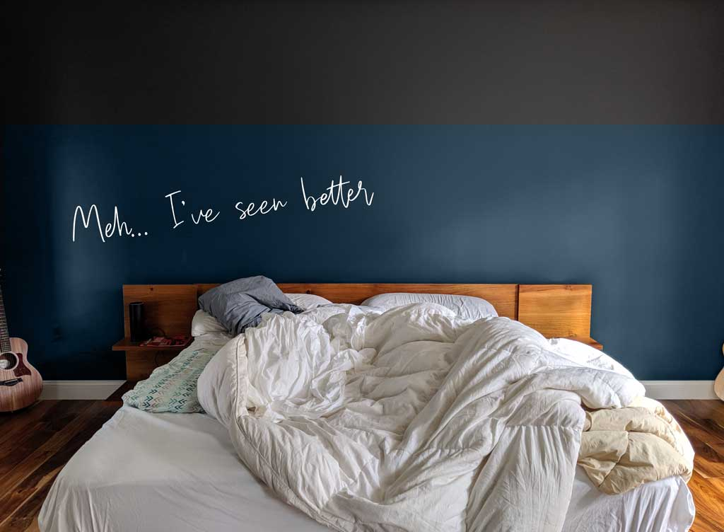 This color block wall doesn't work with the lines of the bed. Too much horizontal!