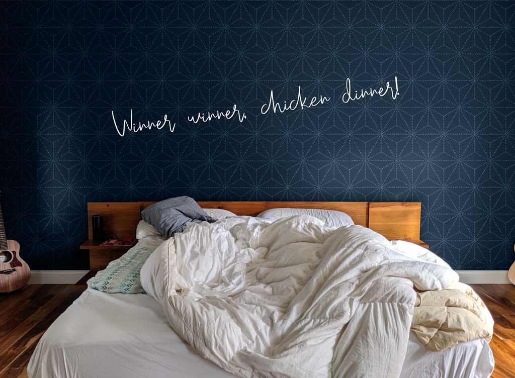 This shibori stencil adds great interest to a dark navy blue wall.