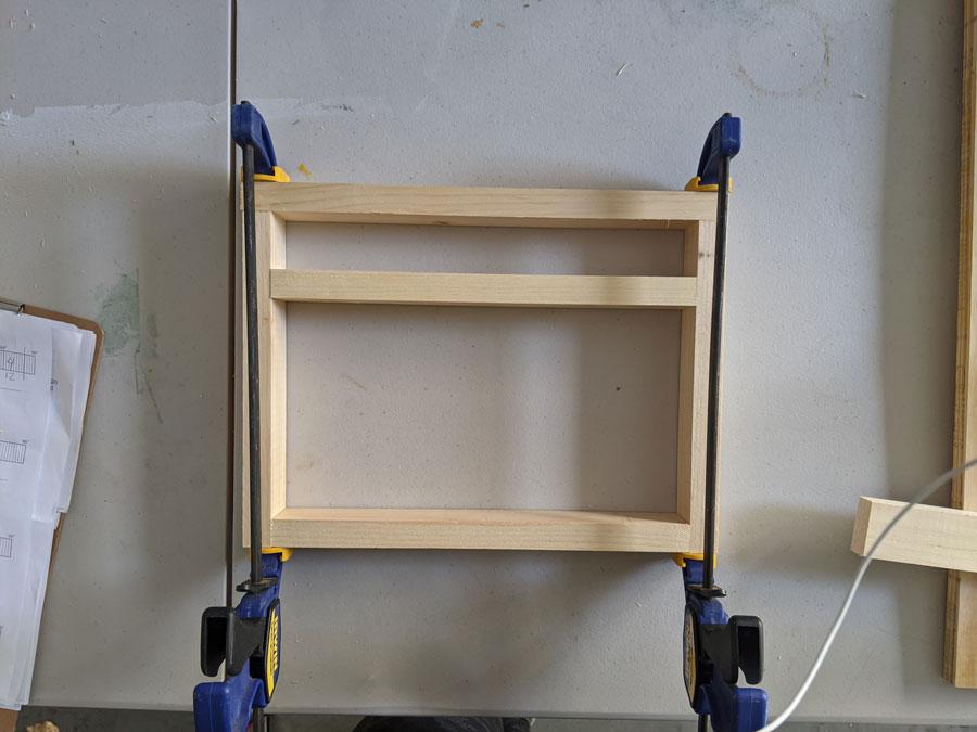 Glue and clamp to horizontal cap to the leg base.