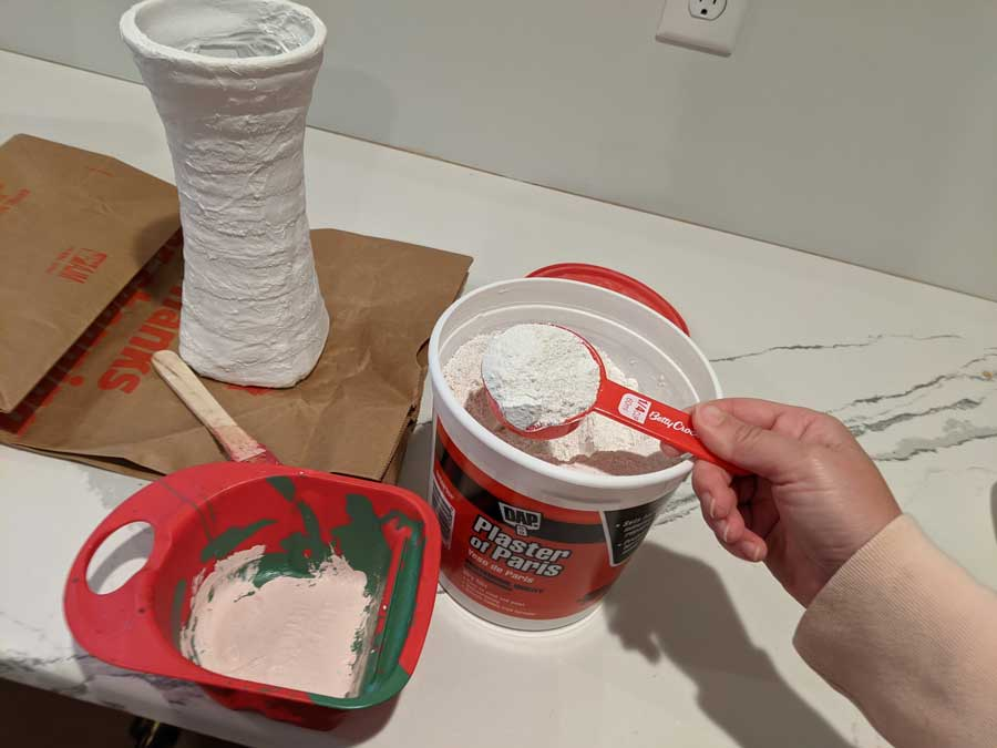 Use two parts plaster to one part cold water to create the correct plaster consistency for painting