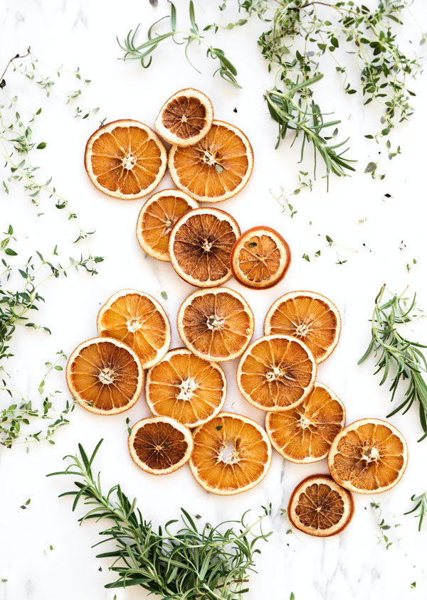 Learn how to make dried orange slices in your oven. These dried citrus slices are perfect for decorating for Christmas and the holidays. In this tutorial, you'll also learn to make orange slice ornaments, wreaths, and swags. These make quick, cheap, and easy DIY Christmas decorations.