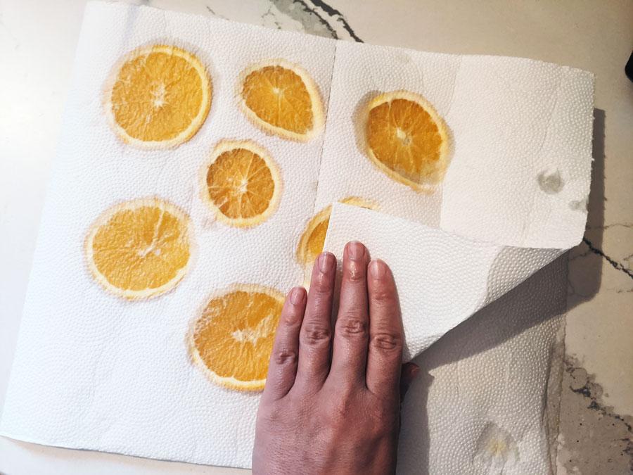 blot oranges to remove moisture