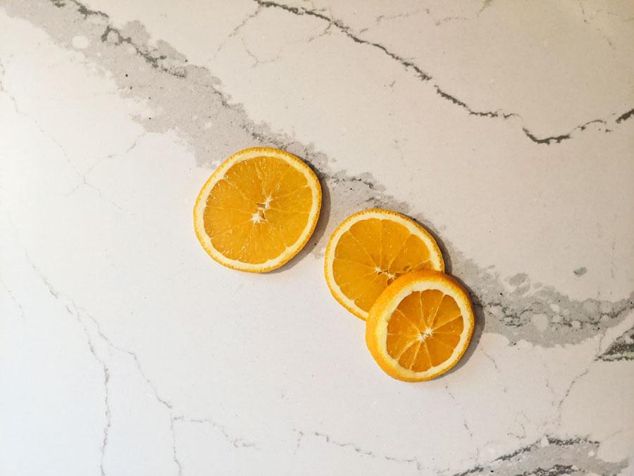 cut oranges into quarter inch slices