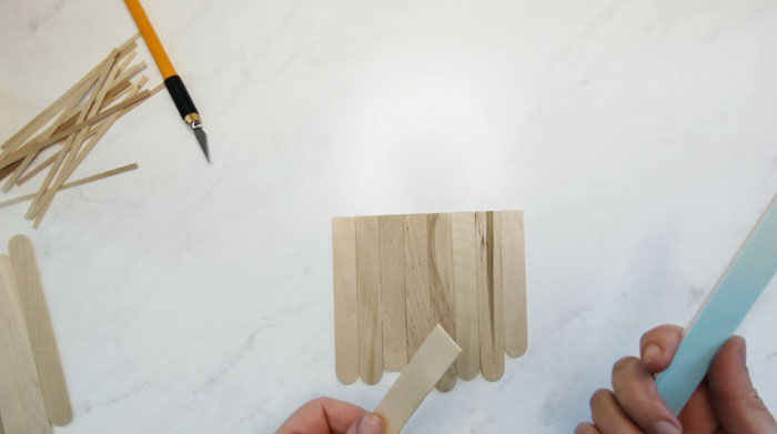 Cut the ends from the craft sticks, perpendicular to the edge
