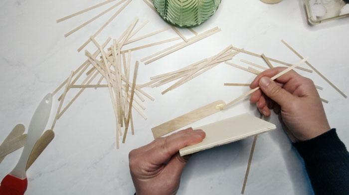 Glue coffee stir sticks around the edge of your wood mosaic coaster