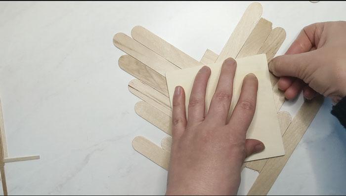 Trim off the excess craft sticks