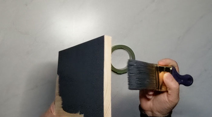 Paint your wood block in the frame color