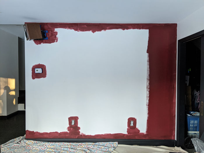 Paint your man cave a favorite color. We chose a deep red.