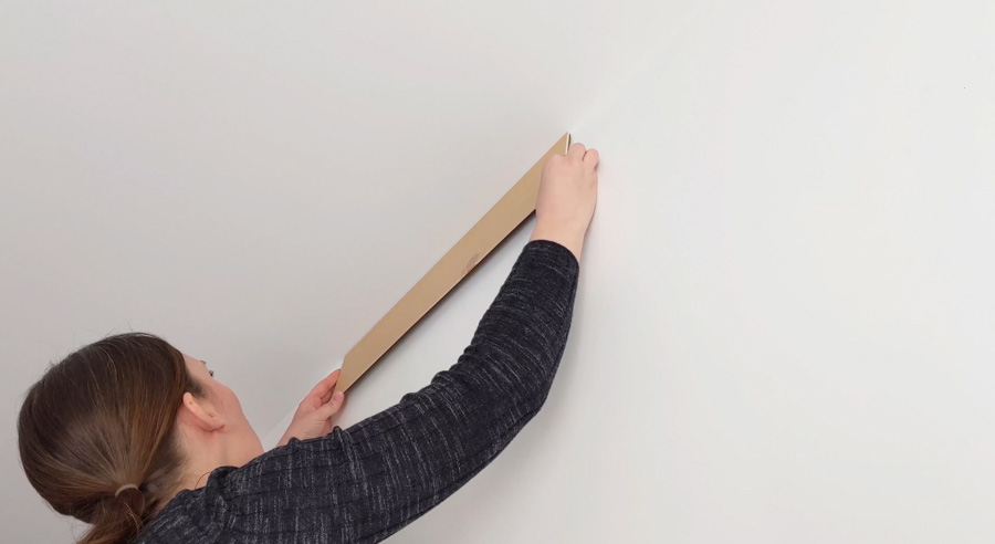 Start first row of peel and stick planks on a level line (your ceiling if it's level)