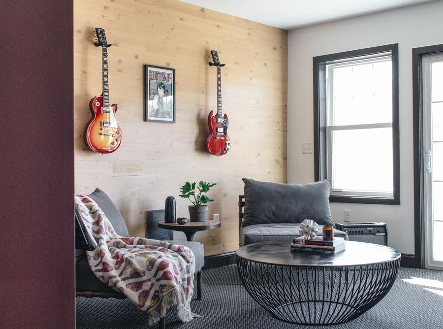 Peeking in on music room with reclaimed wood wall