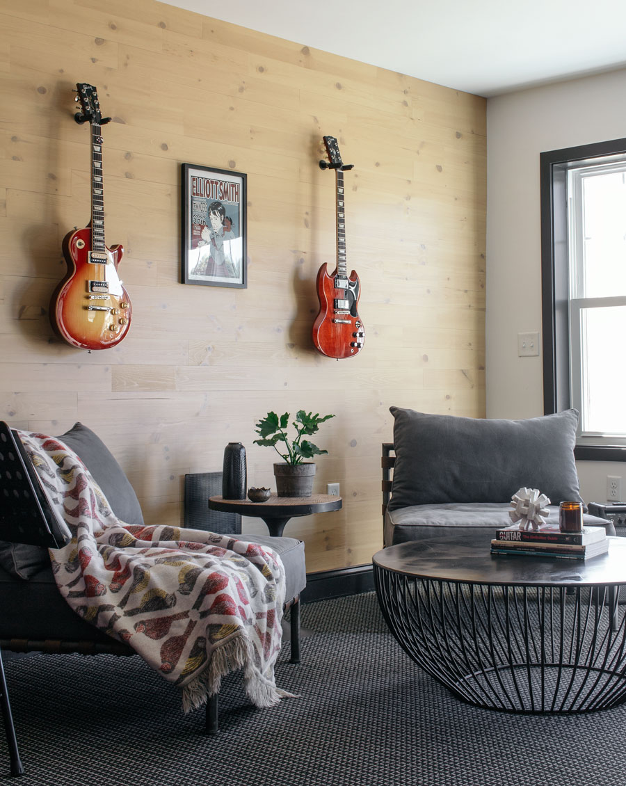 Music room with reclaimed wood wall with guitars hanging
