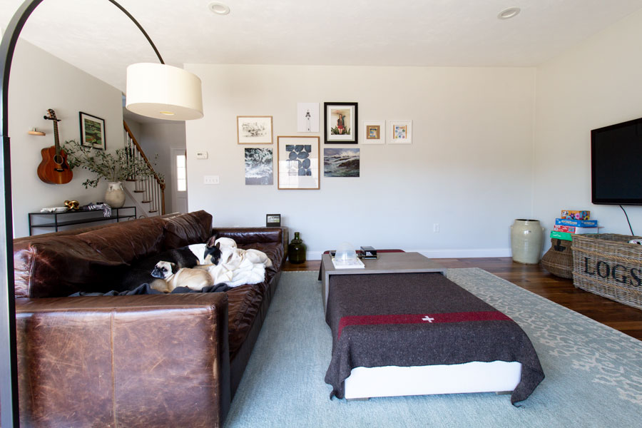 Leather couch in living room with view of wall