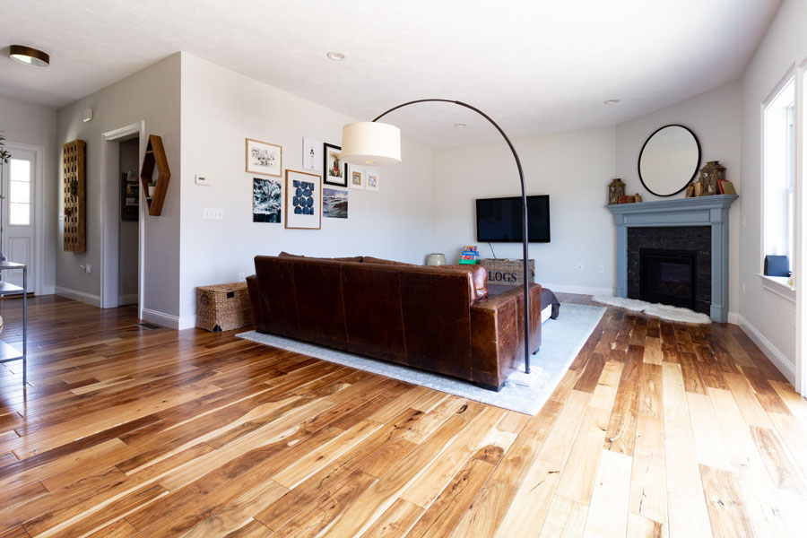 Living room with leather couch, back angle