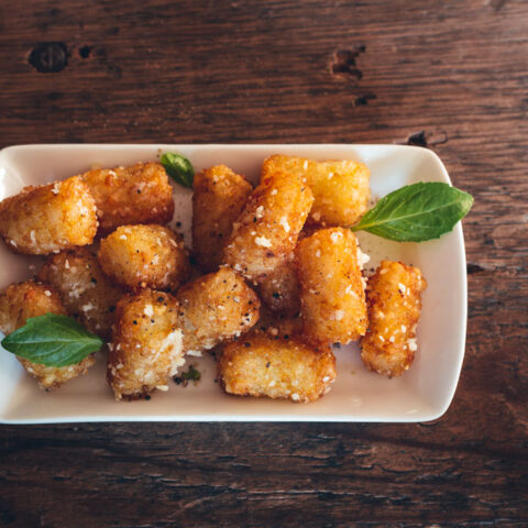 Serve these parmesan truffled tots with a sprinkling of your favorite fresh herbs.