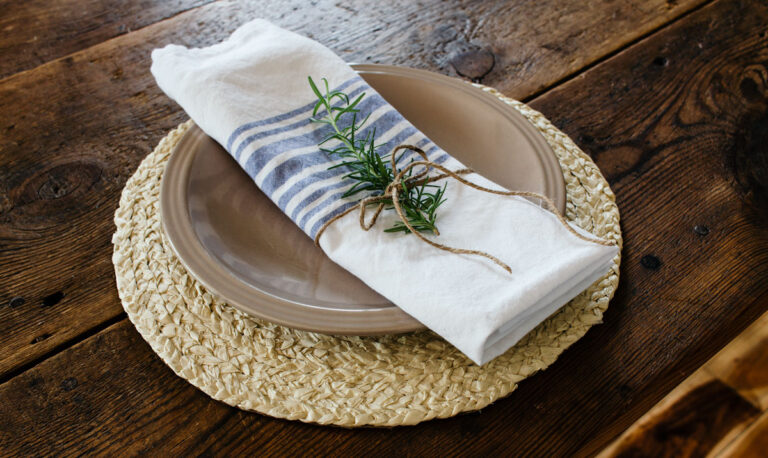DIY a full set of coastal style seagrass chargers that only look expensive.
