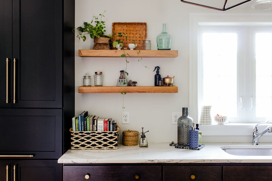 Styling open shelving in dark cabinet kitchen