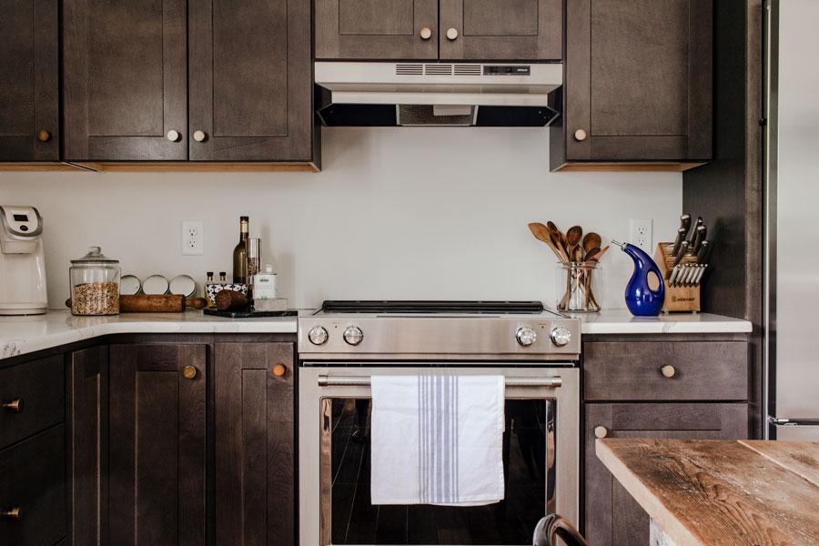 Stainless steel stove in dark kitchen