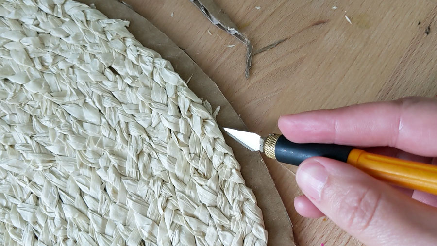 Trim the excess cardboard from the edges of your DIY seagrass placemat