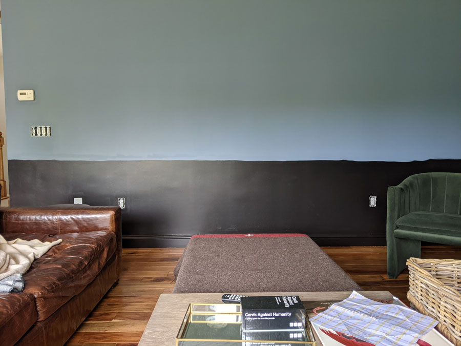 black and blue wall with leather couch